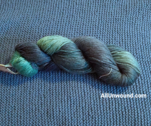 AllUnwound.com Frozen Ocean Swiss Silk skein on cotton garter stitch hand knit