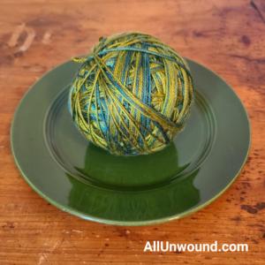 AllUnwound Swiss Silk Handmaiden yarn Hemlock looking very olive on green vintage Fiesta