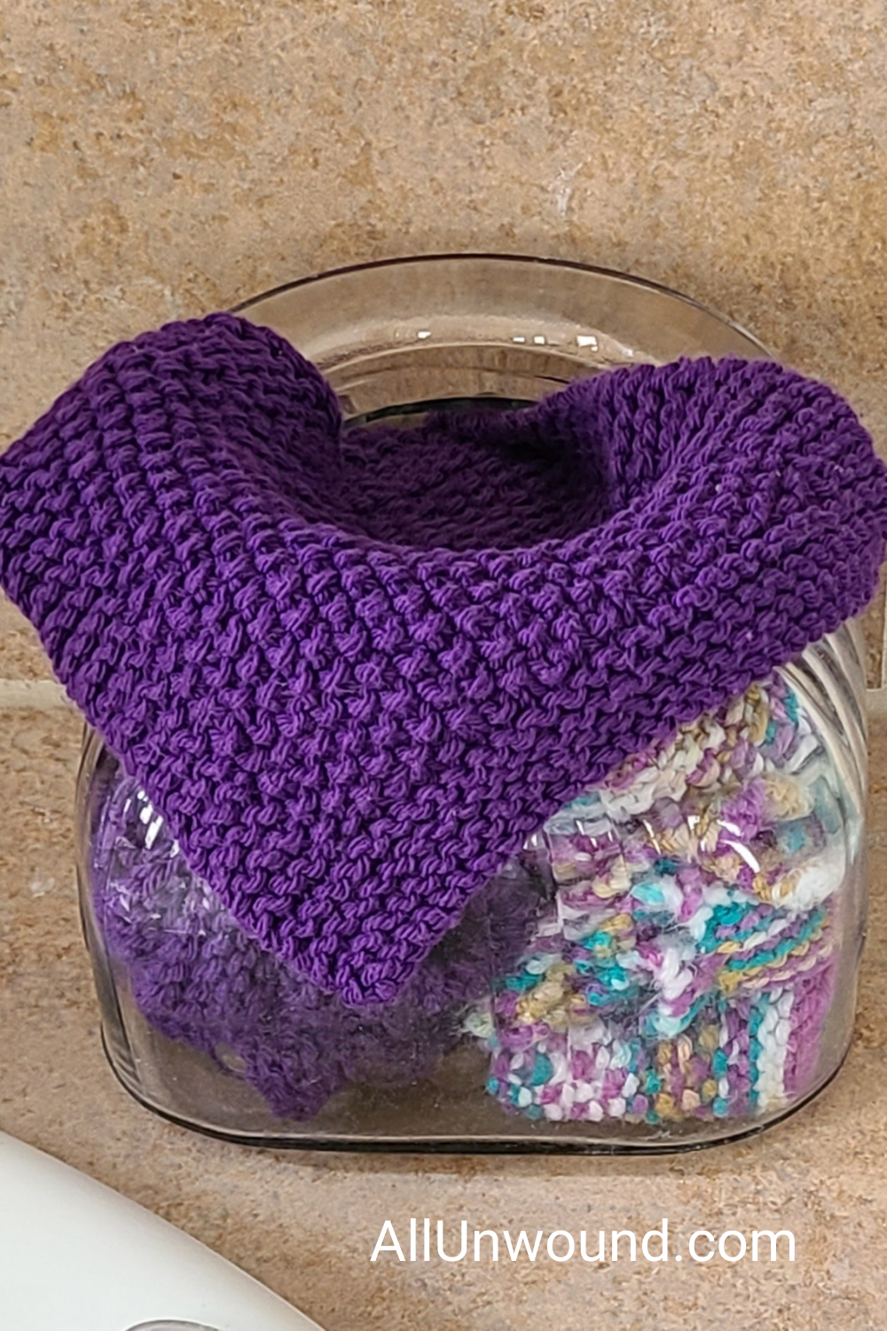 Jar with purple and multicolored hand knit spa washcloths AllUnwound.com