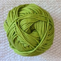 All Unwound ball of bright green yarn.